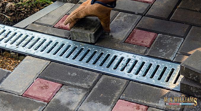 how to clean underground gutter drains